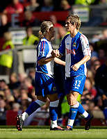 Photo: Jed Wee.<br />Manchester United v Blackburn Rovers. The Barclays Premiership. 24/09/2005.<br /><br />Blackburn's Morten Gamst Pedersen (R) is congratulated by Tugay after his goal.