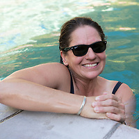 Smiling woman in the main pool. Belknap Hot Springs is a resort, campground, and hot springs located near McKenzie Bridge, Oregon.