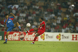 BANGKOK, THAILAND - Thailand. Thursday, July 24, 2003: Liverpool's Florent Sinama-Pongolle and Thailand's Kraikiat Bedtaki during a preseason friendly match at the Rajamangala National Stadium. (Pic by David Rawcliffe/Propaganda)