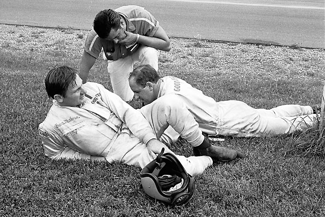 Bruce McLaren and Denny Hulme with tire tech during practice for 1969 St. Jovite Can-Am.