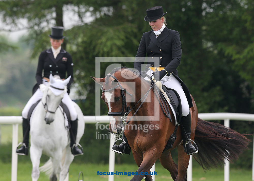 Tattersalls International Horse Trials at Tattersalls, Ratoath<br /> Competitors warm up before the dressage competition<br /> Picture by Lorraine O'Sullivan/Focus Images Ltd +353 872341584<br /> 30/05/2014