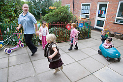 Group of playschool children having fun at breaktime,