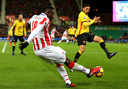 Mame Biram Diouf of Stoke City crosses the ball ahead of Jose Holebas of Watford - Mandatory by-line: Matt McNulty/JMP - 03/01/2017 - FOOTBALL - Bet365 Stadium - Stoke-on-Trent, England - Stoke City v Watford - Premier League