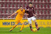 Scott Pittman (#8) of Livingston FC tackles Michael Smith (#2) of Heart of Midlothian during the 4th round of the William Hill Scottish Cup match between Heart of Midlothian and Livingston at Tynecastle Stadium, Edinburgh, Scotland on 20 January 2019.