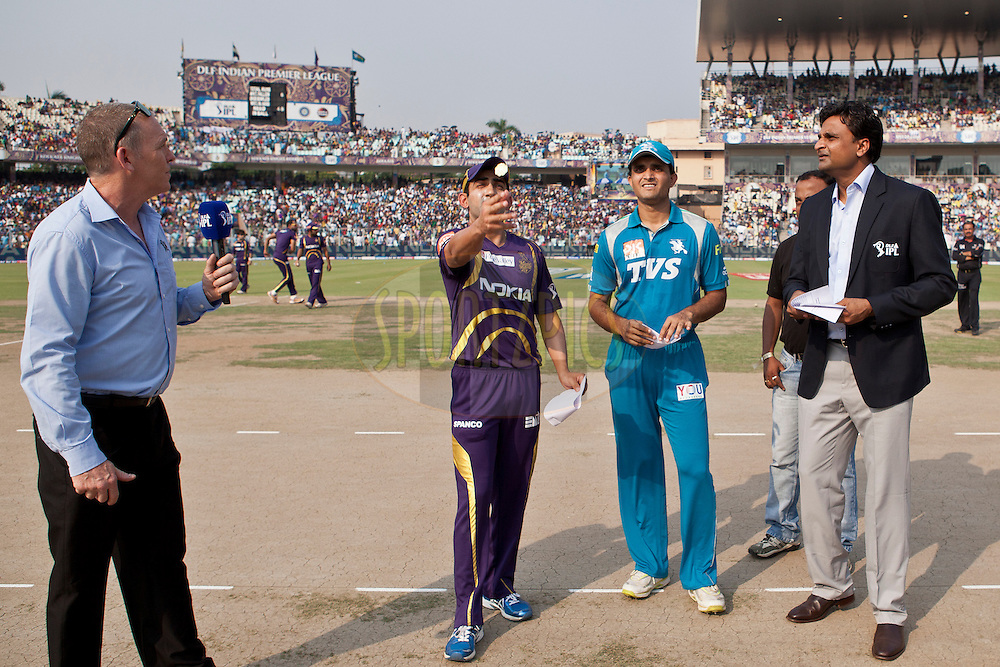 KKR captain Gautam Gambhir(L) lift the coin for toss during match 47 of the the Indian Premier League ( IPL) 2012  between The Kolkata Knight Riders and The Pune Warriors India held at the Eden Gardens Stadium in Kolkata on the 5th Mayl2012..Photo by Saikat Das/IPL/SPORTZPICS
