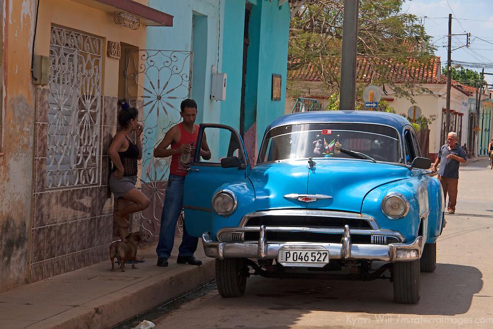 Central America, Cuba, Remedios. Cuban and classic car.