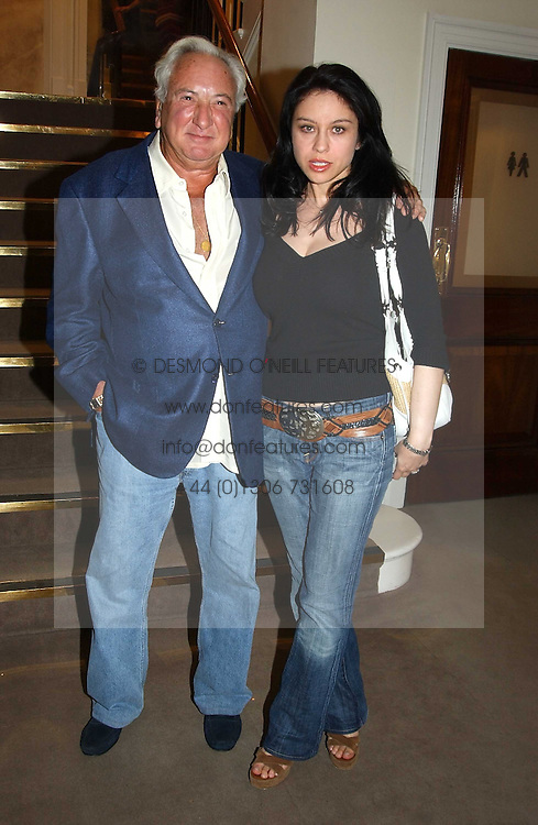 MICHAEL WINNER and PAOLA LOMBARD at auctioneers Sotheby's Summer party held at their showrooms in 34-35 New Bond Street, London W1 on 6th June 2005.<br />