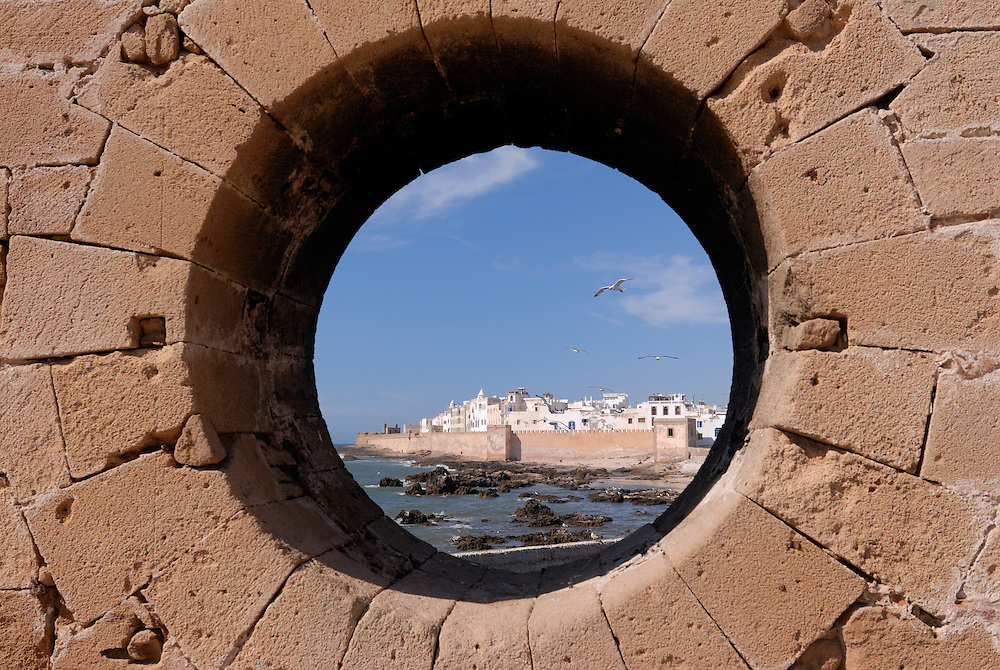 The view through a big stone pipe to the coast and the city of Essaouira. Morocco. Africa.