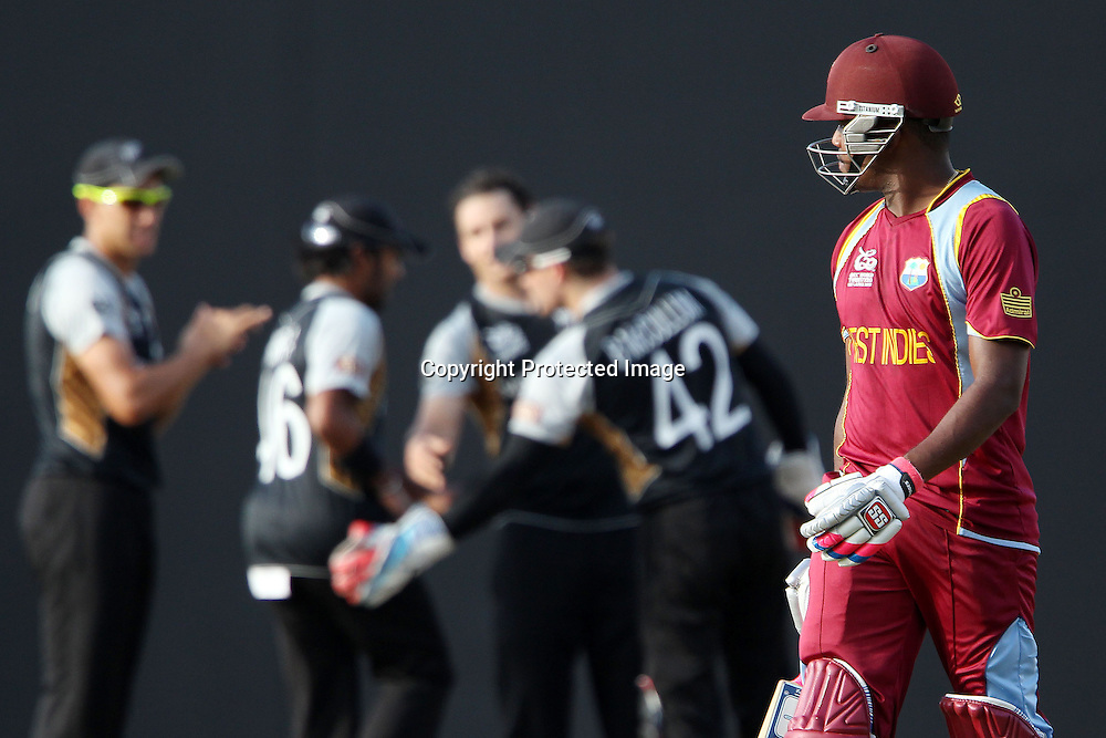Darren Bravo of The West Indies departs as New Zealand celebrate his wicket during the ICC World Twenty20 Super Eights match between The West Indies and New Zealand held at the  Pallekele Stadium in Kandy, Sri Lanka on the 1st October 2012<br /> <br /> Photo by Ron Gaunt/SPORTZPICS/PHOTOSPORT