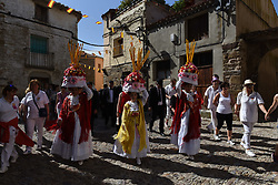 June 24, 2017 - San Pedro Manrique, Soria, Spain - A group of women called 'Móndidas' dressed in traditional costumes and wearing huge 'Cestaños', hats decorated with flowers and branches, covered with unleavened bread and colored with saffron, pictured during the celebration of the ancient tradition of 'La Descubierta' in San Pedro Manrique, northern Spain. (Credit Image: © Jorge Sanz/Pacific Press via ZUMA Wire)