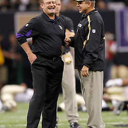 September 9, 2010; New Orleans, LA, USA;  New Orleans Saints head coach Sean Payton and Minnesota Vikings head coach Brad Childress talk during warm ups prior to the NFL Kickoff season opener between the Minnesota Vikings and the New Orleans Saints at the Louisiana Superdome. Mandatory Credit: Derick E. Hingle