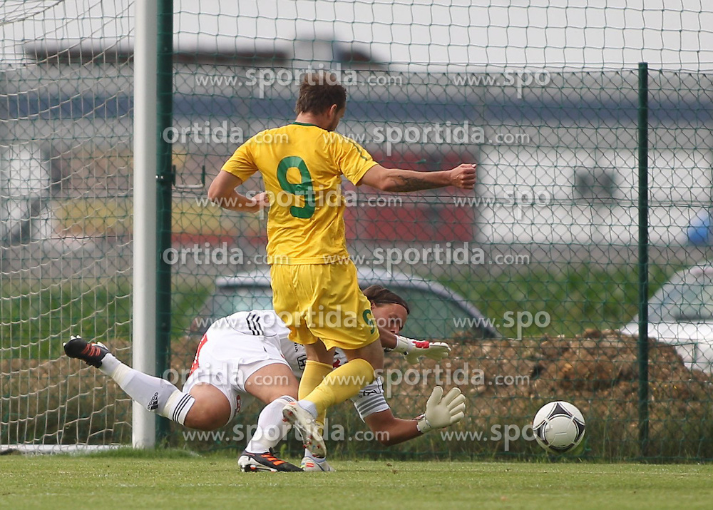 22.06.2012, Sportplatz SK Kammer, Kammer, AUT, 1. FBL, Testspiel, SV Josko Ried vs MSK Zilina, im Bild Thomas Gebauer, (SV Josko Ried, #1) und Roman Gergel, (MSK Zilina, #09)// Thomas Gebauer, (SV Josko Ried, #1) and Roman Gergel, (MSK Zilina, #09)during Preparation Game for the 1. FBL between SV Josko Ried and MSK Zilina at the Sportplatz SK Kammer, Kammer, Austria on 2012/06/22 . EXPA Pictures © 2012, PhotoCredit: EXPA/ R. Hackl