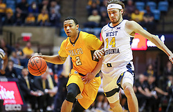 Nov 24, 2018; Morgantown, WV, USA; Valparaiso Crusaders guard Deion Lavender (2) drives past West Virginia Mountaineers guard Chase Harler (14) during the first half at WVU Coliseum. Mandatory Credit: Ben Queen-USA TODAY Sports