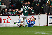 Hibernian FC Defender Lewis Stevenson getting tackled during the Scottish League Cup semi-final match between Hibernian and St Johnstone at Tynecastle Stadium, Gorgie, Scotland on 30 January 2016. Photo by Craig McAllister.
