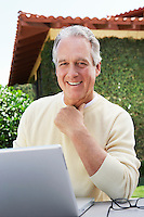 Man Using Laptop in Garden