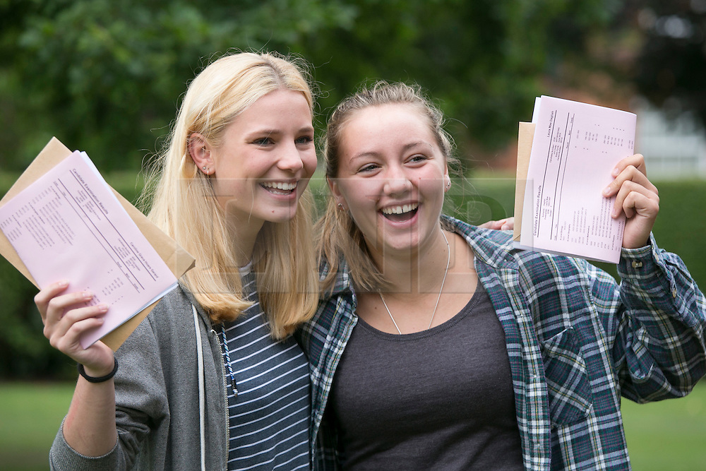 © Licensed to London News Pictures. 13/08/2015. Solihull, West Midlands, UK. A level results day at Solihull School. A record breaking year for the school as it had 88% of students with A Star to B passes. Pictured, Caroline Gerard, left, off to university to study American studies and Laura Dalglish to take Mechanical Engineering. Photo credit : Dave Warren/LNP