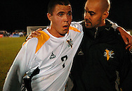 19 NOV. 2020 -- FENTON, Mo. -- St. John Vianney High School soccer player Shane Mihaljevic (7) is congratulated by Vianney assistant coach Tim Tedoni after the Griffins beat St. Louis University High School 2-0 during the MSHSA Class 3 state soccer semifinal at the A-B Center in Fenton, Mo. Friday, Nov. 19, 2010. Vianney advances to the Class 3 title game Saturday night. Image © copyright 2010 Sid Hastings.