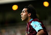 Photo: Chris Ratcliffe.<br /> West Ham United v Aston Villa. The Barclays Premiership. 10/09/2006.<br /> Carlos Tevez of West Ham.