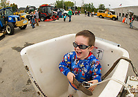 Jacob checks out the safety harness for the bucket truck during Explore A Truck day Saturday morning at Laconia's Department of Public Works.  (Karen Bobotas/for the Laconia Daily Sun)