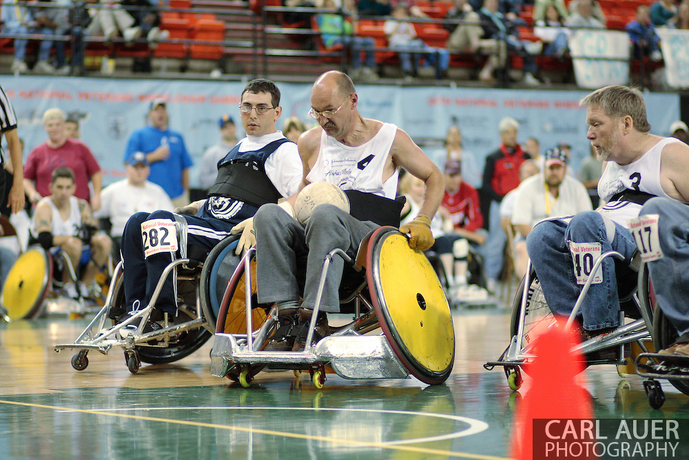 July 7th, 2006: Anchorage, AK - Michael Guilbault (4) speeds into the lane to score as White defeated Blue in the gold medal game of Quad Rugby at the 26th National Veterans Wheelchair Games.