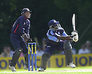 .14/07/2002 - Sport - Cricket- Norwich Union League..Middlesex Crusaders vs Gloucester Gladiators.Mark Allenyne strikes a boundary, only to be caught by Ed Joyce for 93.