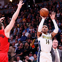 09 April 2018: Denver Nuggets guard Gary Harris (14) takes a jump shot over Portland Trail Blazers guard Pat Connaughton (5) during the Denver Nuggets 88-82 victory over the Portland Trail Blazers, at the Pepsi Center, Denver, Colorado, USA.