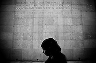 A female visitor passes a stone pylons with the names of 371 missing soldiers at The Luxembourg American Cemetery and Memorial. The memorial is the burial area containing 5,076 of military dead during the Second World War. Photo: ©Erik Luntang