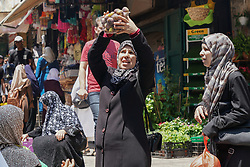 Women inspect fruit on sale in the Old City of Jerusalem. From a series of travel photos taken in Jerusalem and nearby areas. Photo date: Thursday, August 2, 2018. Photo credit should read: Richard Gray/EMPICS