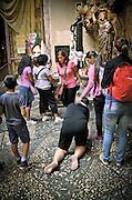 Palermo:penitents in the sanctuary of Saint Rosalia.<br /> Palermo: fedeli in cerca di grazia nel  santuario di Santa Rosalia