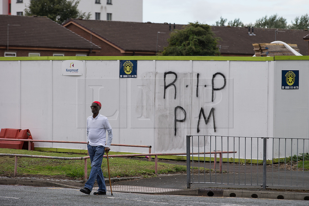 "© Licensed to London News Pictures . 28/08/2015 . Salford , UK . RIP PM graffiti on hoardings on Churchill Way , near to St Paul's CE Church . The funeral of Paul Massey at St Paul's CE Church in Salford . Massey , known as Salford's "" Mr Big "" , was shot dead at his home in Salford last month . Photo credit : Joel Goodman/LNP"