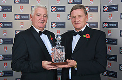 CARDIFF, WALES - Wednesday, November 11, 2009: Wales' special award winner Gary Sprake with President Phil Pritchard during the Football Association of Wales Player of the Year Awards hosted by Brains SA at the Cardiff City Stadium. (Pic by David Rawcliffe/Propaganda)