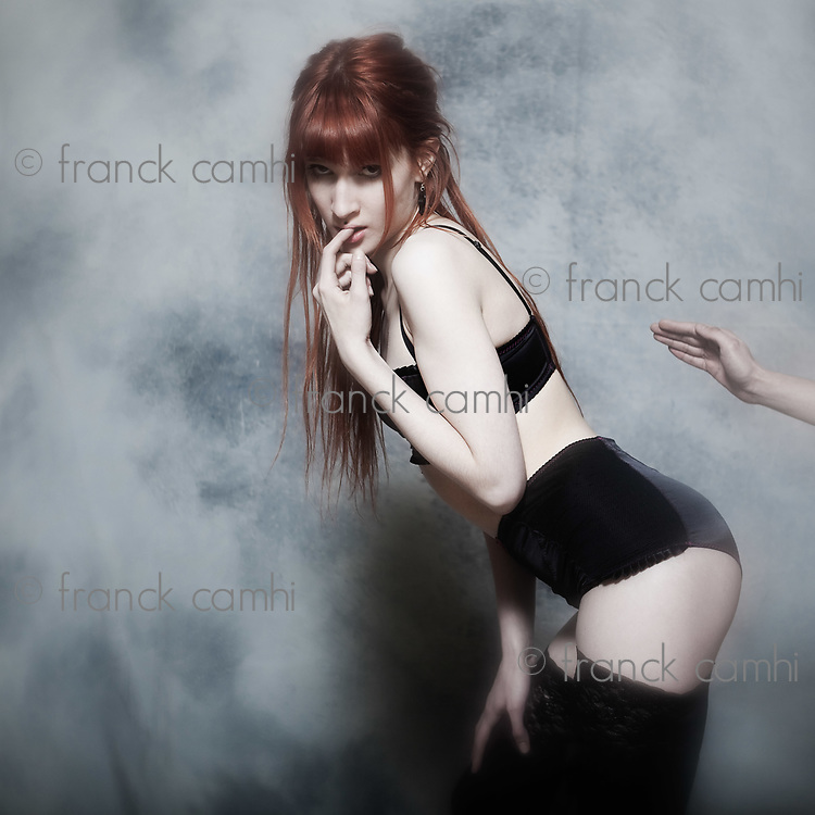 studio shot of a beautiful cute babe with underwear on isolated background