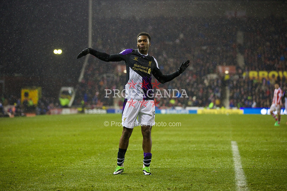 STOKE-ON-TRENT, ENGLAND - Sunday, January 12, 2014: Liverpool's Daniel Sturridge celebrates scoring the fifth goal against Stoke City during the Premiership match at the Britannia Stadium. (Pic by David Rawcliffe/Propaganda)