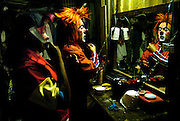 The Cole Bros. Circus clowns add finishing touches to their wigs and face paint in a trailer behind the circus tent before a show in Augusta, Georgia.