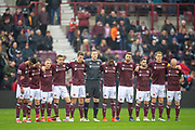 Hearts players stand arm in arm during the minute's silence, as a tribute to Freddie Glidden before the 4th round of the William Hill Scottish Cup match between Heart of Midlothian and Livingston at Tynecastle Stadium, Edinburgh, Scotland on 20 January 2019.