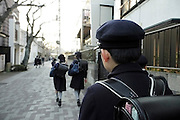 young school boys and girls in uniform walking on the street Japan Kamakura
