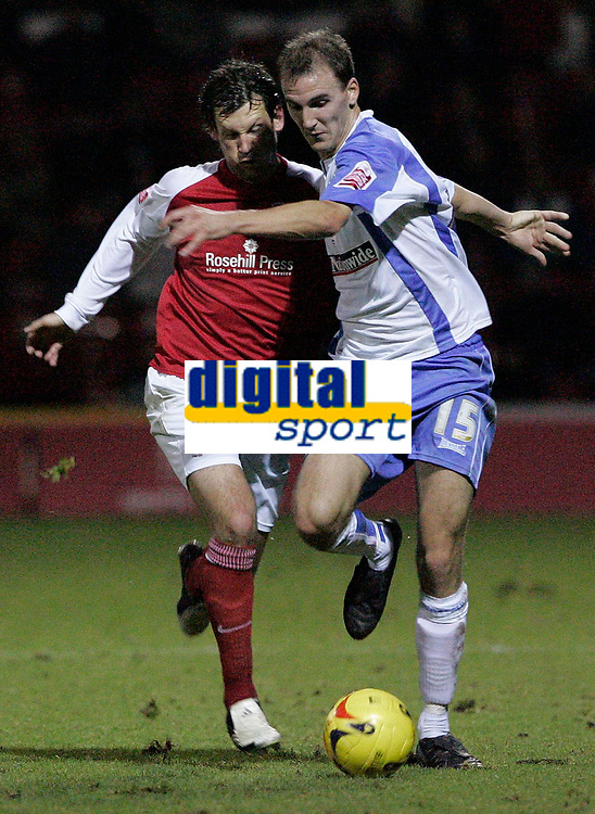 Photo: Dave Howarth.<br />Rotherham United v Swindon Town. Coca Cola League 1.<br />03/12/2005.  <br />Swindon's Andrew Nicholas (R) and Rotherham's Paul McLaren battle for the ball