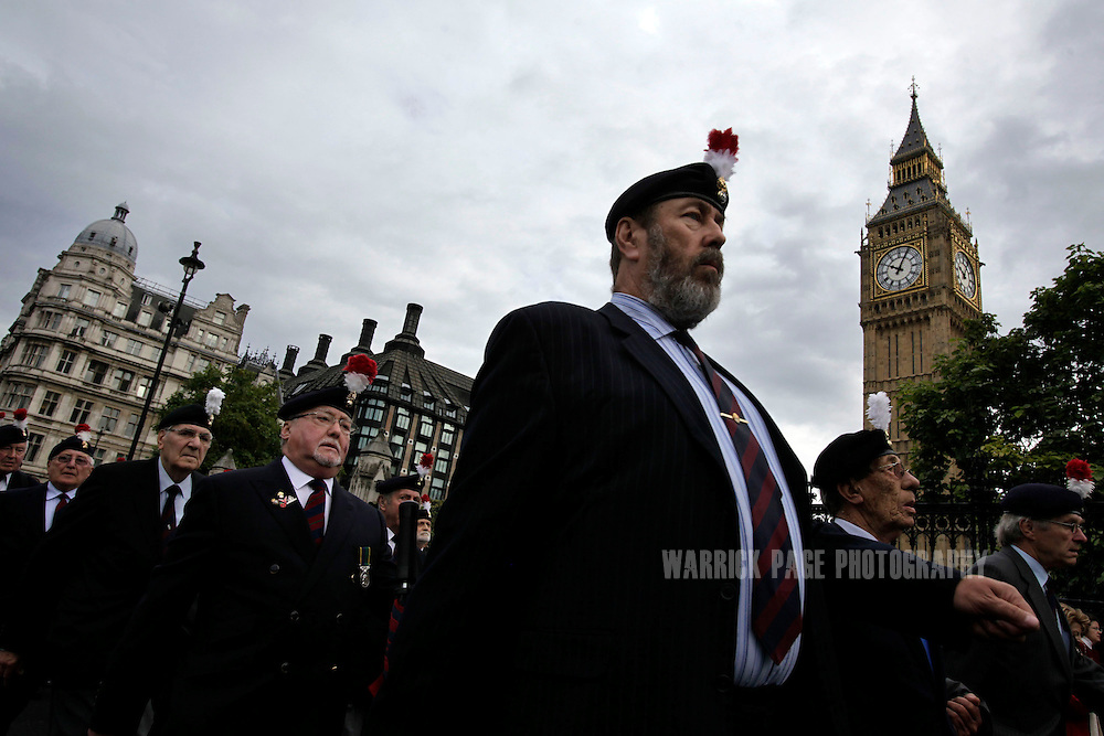 LONDON, ENGLAND - OCTOBER 18: Veteran soldiers from the Second Battalion of the Royal Regiment of Fusiliers march in protest towards Parliament, October 18, 2012, in London, England. Members of the regiment are protesting defence cuts which may result in the disbandment of the unit. (Photo by Warrick Page)