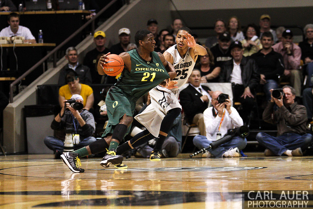 March 3, 2013: Boulder, Colorado - Colorado Buffaloes sophomore guard Spencer Dinwiddie (25) grabs onto the jersey of University of Oregon Ducks freshman guard Damyean Dotson (21) in the NCAA basketball game between the Oregon Ducks and the Colorado Buffaloes at the Coors Events Center