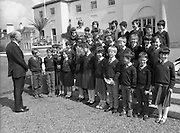 President Hillery Meets Schoolchildren at The Arás.(R59)..1987..15.06.1987..06.15.1987..15th June 1987..As part of an educational tour pupils from Scoil Barra, Ballincollig, Cork were treated to a tour of Arás on Uachtaráin. The pupils were very lucky as the president himself,Dr Hillery, pointed out the highlights of the Arás. With the party was the class teacher Ms Orla Murphy...Image shows President Patrick Hillery greeting the children on the steps of the Arás.