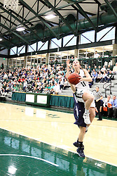 20 February 2016:  Molly McGraw makes a sweeping move to the hoop during an NCAA women's basketball game between the Elmhurst Bluejays and the Illinois Wesleyan Titans in Shirk Center, Bloomington IL
