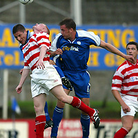 St Johnstone v Hamilton Accies 06.08.02<br />Ian Maxwell and Grant Murray clear from Grant Armstrong<br /><br />Pic by Graeme Hart<br />Copyright Perthshire Picture Agency<br />Tel: 01738 623350 / 07990 594431