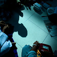 BANGKOK, NOVEMBER 28, 2008: muslims play cards while waiting for a charter flight to Mecca at Bangkok's Suvarnabhumi international airport  on Thursday, November 28th 2008. The campaign by the PAD, which began in earnest in May, has paralysed the Thai government. The group - an alliance of royalists, businessmen and the urban middle class - claim that the government is corrupt and hostile to the monarchy. They also accuse it of being a proxy for former PM Thaksin Shinawatra, who remains very popular among Thailand's rural poor.