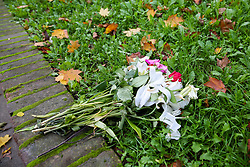 © Licensed to London News Pictures. 28/10/2019. London, UK. Floral tributes are left on Mingard Walk in Islington, north London.<br /> Detectives have launched a murder investigation after a woman died in a fire at a residential address in Islington.<br /> Police were called at 12:41hrs on Saturday, 26 October following reports of a fire in a flat on Mingard Walk, N7.<br /> Officers attended along with the London Ambulance Service and the London Fire Brigade. A woman [no further details at this time] was pronounced dead at the scene. A man, believed to be aged in his 30s, was found suffering serious injuries. He was taken to hospital where he remains in a critical condition. <br /> The fire is being treated as suspicious. Photo credit: Dinendra Haria/LNP