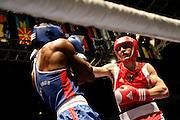 Milan, 02-09-2009 ITALY - Aiba World Boxing Championship Milan 2009.  Middle 75 kg preliminaries..Pictured: Buga Konstantin GER red vs De Rosario Jacinto CPV blue.Photo by Giovanni Marino/OTNPhotos . Obligatory Credit