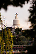 View at sunset of the White Dagoba Tibetan style stupa in Beihai Park in Beijing, China