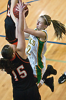 JEROME A. POLLOS/Press..Lakeland High's Camille Reynolds flies toward the hoop and Jerome High defender Tinley Garey in the second half of the Hawk's 69-52 loss to Jerome High in the 4A state championship tournament consolation game held Saturday in Meridian.