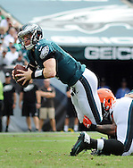 Philadelphia Eagles quarterback Carson Wentz is tackled by a Cleveland Browns defender, September 11, 2016 at Lincoln Financial Field in Philadelphia, Pennsylvania.  (Photo by William Thomas Cain)