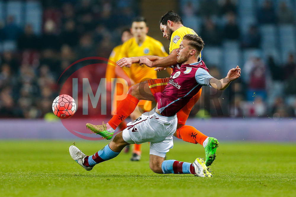 Sam Wood of Wycombe Wanderers and Jordan Lyden of Aston Villa compete for the ball - Mandatory byline: Rogan Thomson/JMP - 19/01/2016 - FOOTBALL - Villa Park Stadium - Birmingham, England - Aston Villa v Wycombe Wanderers - FA Cup Third Round Replay.