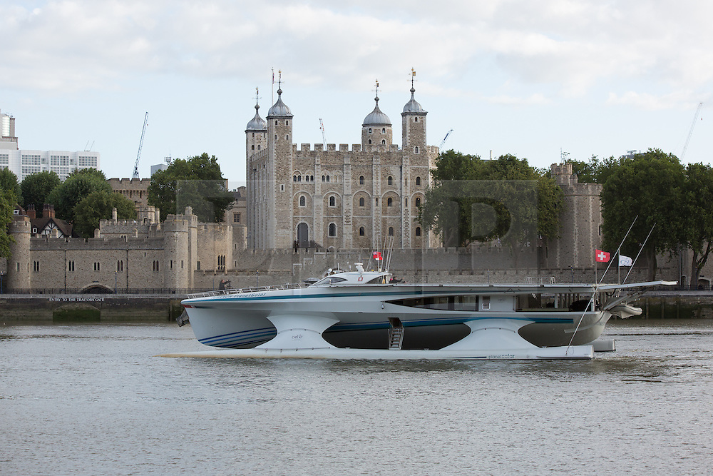 © Licensed to London News Pictures. 31/08/2013. London, UK. MS Tûranor PlanetSolar arrives on the River Thames in London for the first time ever and is seen passing the Tower of London. MS Tûranor PlanetSolar is the world's largest solar powered vessel and has broken the world record for crossing the Atlantic in 22 days. Its solar panels measure 512 square meters and can generate 480kWh on a sunny day.. Photo credit : Vickie Flores/LNP
